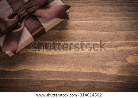 Gift container on vintage wooden board holidays concept.