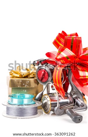 gift for fishers - fishing tackles with red bow. concept surprise for holiday or celebration day