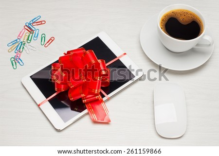 Gift for the holidays tablet with a bow and keyboard - stock photo