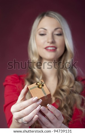 Gift for Valentine's Day for a beautiful girl in the red - stock photo
