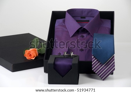 gift idea, men's shirt and choice of ties in elegant box, space for logo and copy - stock photo