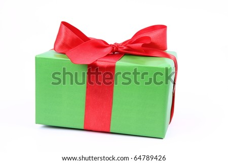 Gift in green wrapping with a red bow on white background - stock photo