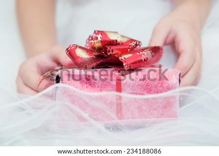 Gift in the hands of a child. - stock photo