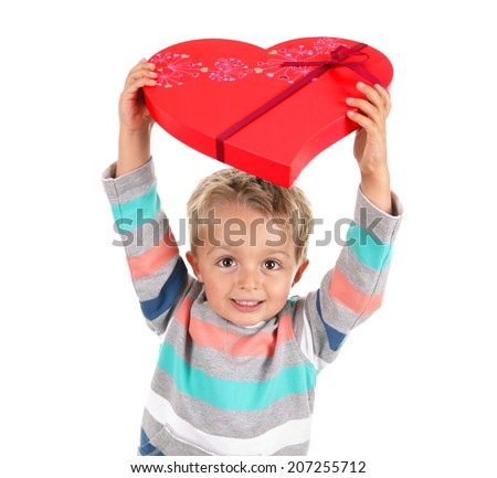 Gift of chocolates in heart shaped box from a young boy