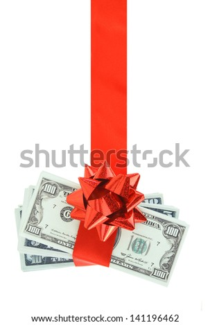 Gift of money hanging on red ribbon - stock photo