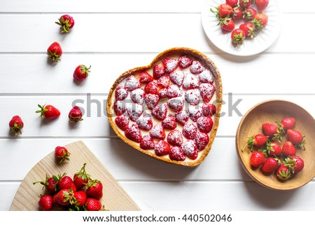 gift on Valentine's Day. Cheesecake in a heart shape. View from above - stock photo