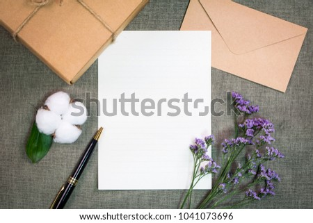 Gift or present box wrapped in kraft paper and flower