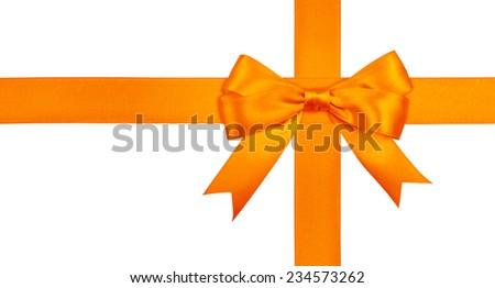 Gift orange ribbon and bow isolated on white background. - stock photo