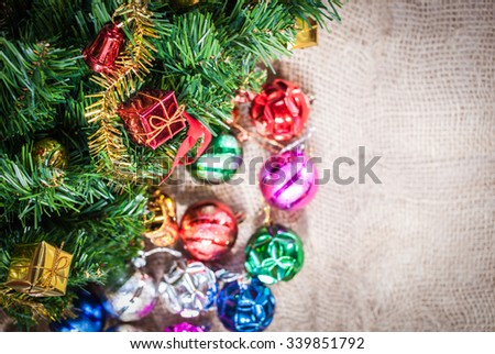 gift ornament and christmas tree on fabric background