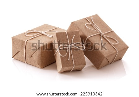 Gift packages wrapped in brown recycled paper isolated on white - stock photo
