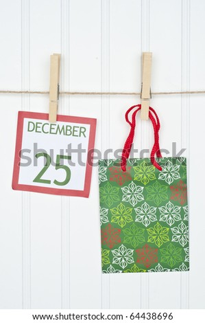 Gift Sack and Christmas Calendar Page on a Clothesline.  Holiday Concept. - stock photo