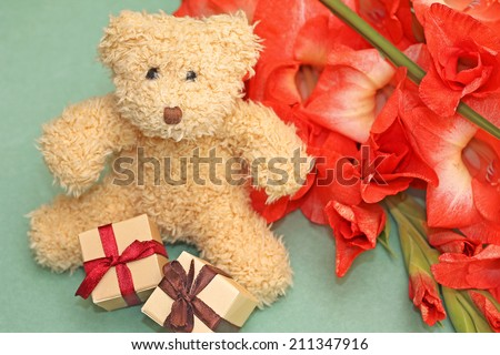 Gift to girlfriend - teddy bear and bouquet of flowers - stock photo