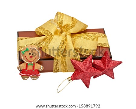 gift with a bow and gingerbread the girl - stock photo