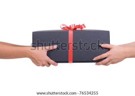 Gift with red ribbon - stock photo