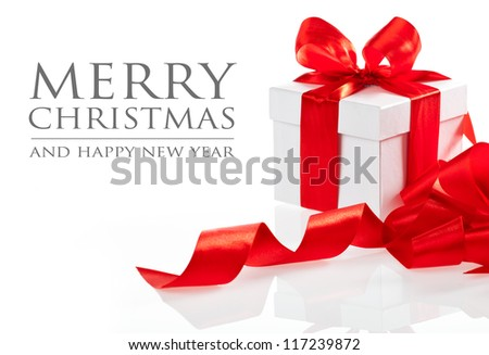 Gift with ribbon and bow isolated on the white background (easy to remove the text)