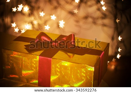 Gift with ribbon - festive background with lights