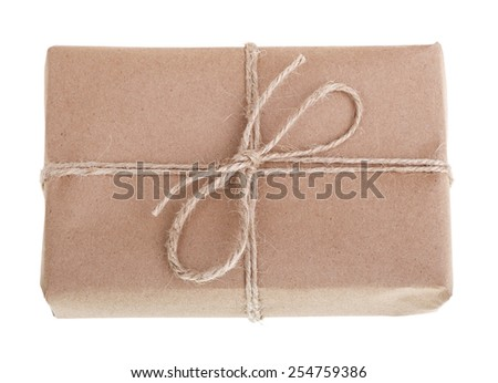 Gift wrapped in brown paper, tied with string isolated on white - stock photo