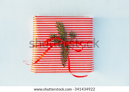 Gift wrapped with a red bow - stock photo