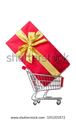 Giftbox and shopping cart on white - stock photo