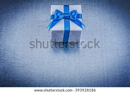 Giftbox blue bow on metallic background horizontal image holidays concept. - stock photo
