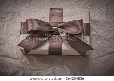 Giftbox with present tape on wrapping paper holidays concept.