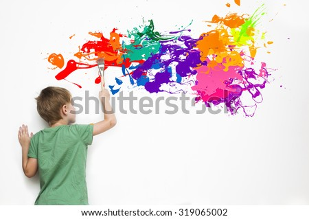 Gifted child drawing an abstract picture with colorful splatters - stock photo