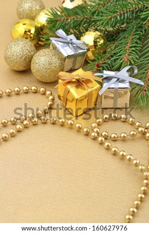 Gifts and Christmas decorations on a spruce branch