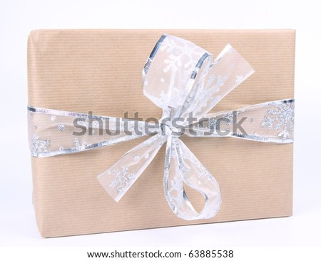 Gifts in paper wrapping with silver bow on white background - stock photo