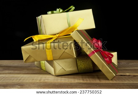 gifts on a black background - stock photo