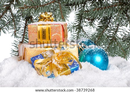 Gifts under a Christmas tree on snow on a white background.