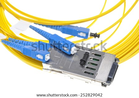 Gigabit Interface Converter with fiber cable on white background - stock photo