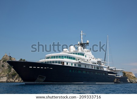 Gigantic big and large luxury yacht with sail boat and helicopter landing place on bord. - stock photo
