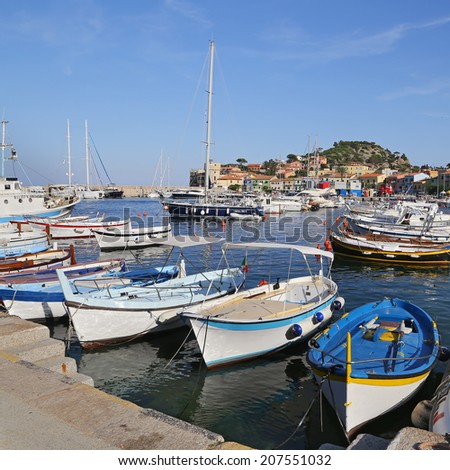 GIGLIO ISLAND, ITALY - JULY 19, 2014:Boats in the small harbor of Giglio Island, the pearl of the Mediterranean Sea, Tuscany - Italy