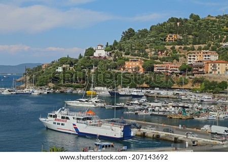 "GIGLIO ISLAND, ITALY - JULY 18, 2014:Boats in the small harbor of ""Porto Santo Stefano"", the pearl of the Mediterranean Sea, Tuscany - Italy"