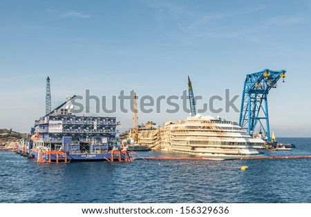 GIGLIO ISLAND, ITALY - SEPTEMBER 26: remains of the tragic sinking of Costa Concordia on September 26, 2013 in Giglio Island, Italy. This is how it looks after the recent successful parbuckling.