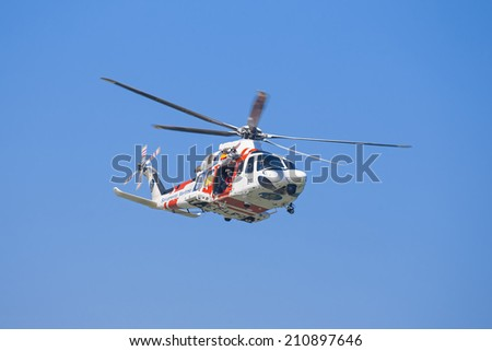 GIJON-SPAIN - JULY 27: AgustaWestland AW139 during exhibition in IX AIR FESTIVAL on july 27, 2014 in Gijon,Spain. - stock photo
