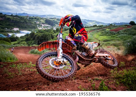 GIJON, SPAIN - MAY 24 2014: Participants in the MX State  Championship held in the city of Gijon, Spain, on Saturday, May 24, 2014. - stock photo