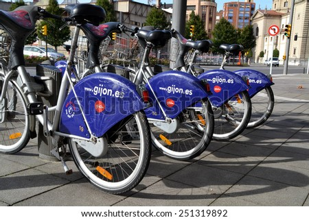 GIJON, SPAIN - OCTOBER 23: Some bicycles of the bike rental service in Gijon, Spain on October 23, 2014. Gijon Bici is a bike sharing service that people can rent bicycles for short trips. - stock photo