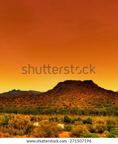 Gila River in Arizona with orange sunset - stock photo
