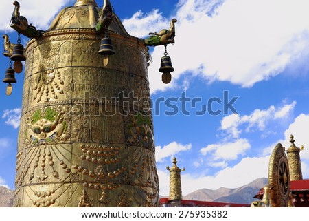 Gilded dhvajas-victory banners and dharmachakra-wheel of dharma-wheel of law on the rooftop of  the AD.642 founded-25000 m2 Jokhang-House of Buddha temple. Lhasa-Tibet. - stock photo