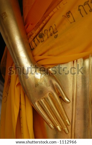 Gilded hand of Buddha from the temple of Nakhon Pathom, Thailand - stock photo