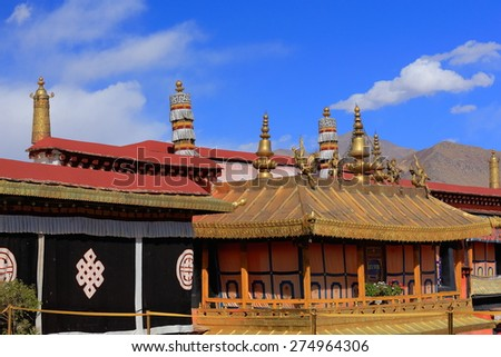 Gilded roofs and decoration atop oriel in the courtyard of the AD.642 founded-25000 m2 Jokhang-House of Buddha temple. Lhasa-Tibet. - stock photo