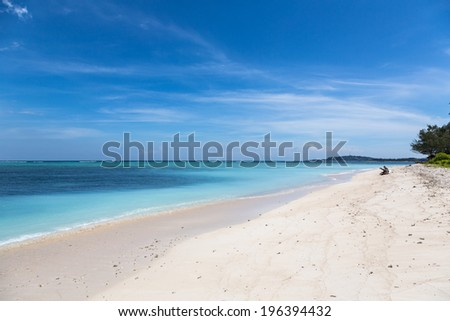Gili Air is a tiny tropical island that lies just off the coast of Lombok in Indonesia. - stock photo
