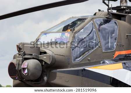 GILZE-RIJEN, NETHERLANDS - JUNE 20: Dutch Air Force AH-64 Apache about to land at the Royal Netherlands Air Force Days June 20, 2014 in Gilze-Rijen, Netherlands.  - stock photo