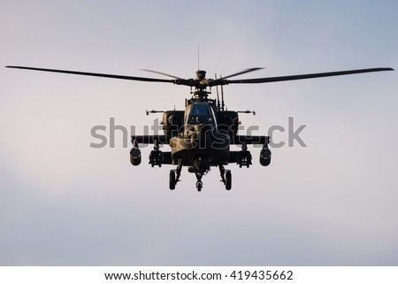 GILZE-RIJEN, THE NETHERLANDS - DECEMBER 14, 2015: Dutch Air Force AH-64 Apache attack helicopter during a training at the Gilze-Rijen Air Base on December 14, 2016, The Netherlands.