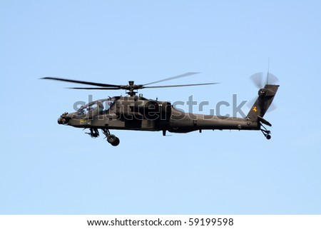 GILZE RIJEN, THE NETHERLANDS - JUNE 18: Dutch Army AH-64 Apache attack helicopter flying on the Royal Dutch Air Force Open House. June 18, 2005 in Gilze-Rijen, The Netherlands