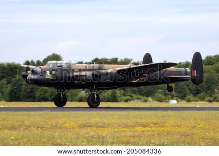 GILZE RIJEN, THE NETHERLANDS - JUNE 21: RAF Historical flight Lancaster WW2 plane flying on the Royal Dutch Air Force Open House. June 21, 2014 in Gilze-Rijen, The Netherlands  - stock photo