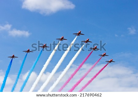 GILZE RIJEN, THE NETHERLANDS - JUNE 21: RAF Red Arrows performing at the Dutch Air Force Open House. June 21, 2014 in Gilze-Rijen, The Netherlands  - stock photo