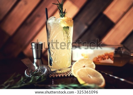 Gin and tonic alcoholic cocktail with lime and ice, served as refreshment drink in local pub. Party starter, nightlife lifestyle - stock photo