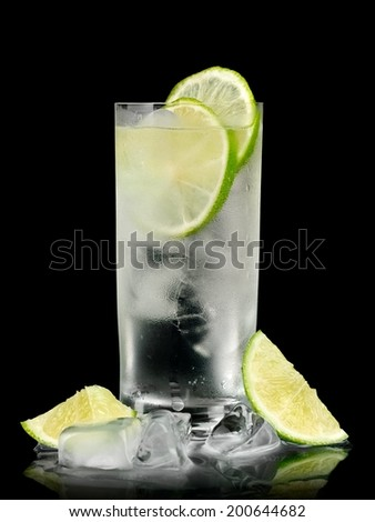 Gin tonic cocktail on black background - stock photo